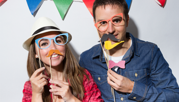 Couple holding photo booth props